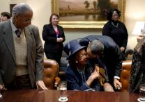 President Barack Obama kisses Dorothy Height during a meeting on Martin Luther King Jr. Day in the Roosevelt Room of the White House on Jan. 18, 2010. President Obama met with a group of African-American seniors and their grandchildren on the legacy of the civil rights movement.