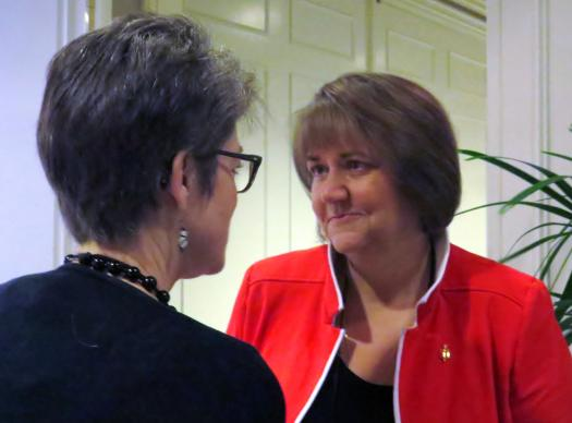 Mountain Sky Area Bishop Karen Oliveto speaks with Northern Illinois Bishop Sally Dyck during a Council of Bishops gathering in Dallas on April 30.