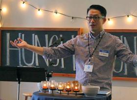 "The Rev. Samuel S. Yun, lead pastor of Embrace Church in Oakland, California, officiates during worship services. Yun took particular inspiration from Habakkuk 2:2: ""Write a vision, and make it plain upon a tablet so that a runner can read it."" Photo courtesy of Embrace Church."