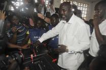 In this Oct. 10, 2017, file photo, former soccer star George Weah, presidential candidate for the Coalition for Democratic Change, casts his vote during the presidential election in Monrovia, Liberia. Weah was elected by more than 61 percent of the vote over his rival, Vice President Joseph N. Boakai, during a Dec. 26 presidential runoff election. AP Photo/Abbas Dulleh, File.
