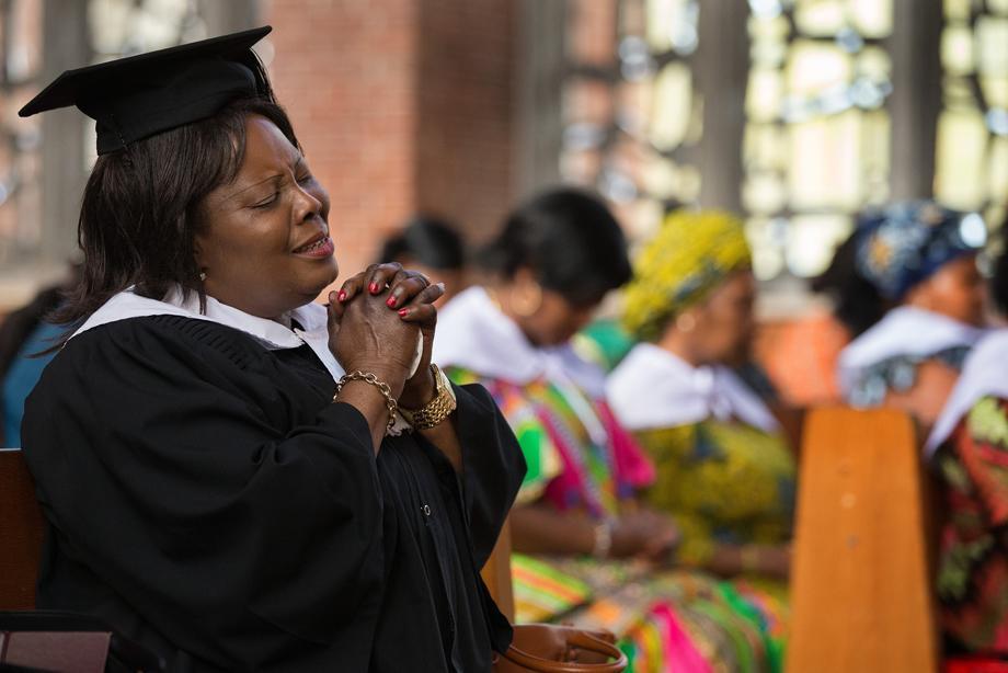 Choir member Juliana Amoah prays during worship at Calvary United Methodist Church, a Ghanaian congregation in Hamburg, Germany. Photo by Mike DuBose, UMNS.