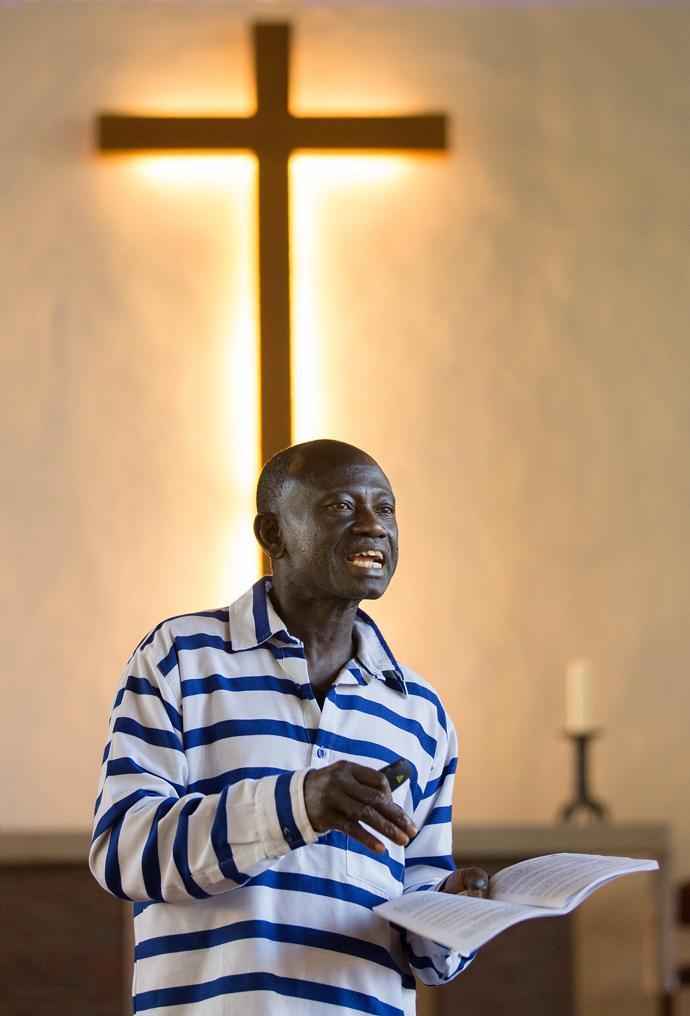 Adu Sarkodie leads Bible study at Ebenezer United Methodist Church. Photo by Mike DuBose, UMNS.