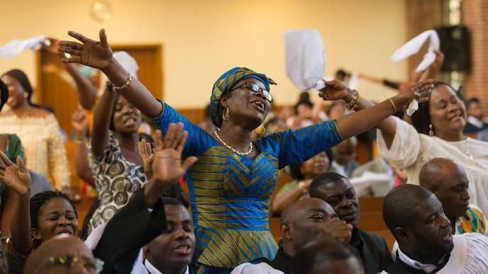 Members of the congregation sing during worship at Calvary United Methodist Church. Photo by Mike DuBose, UMNS.