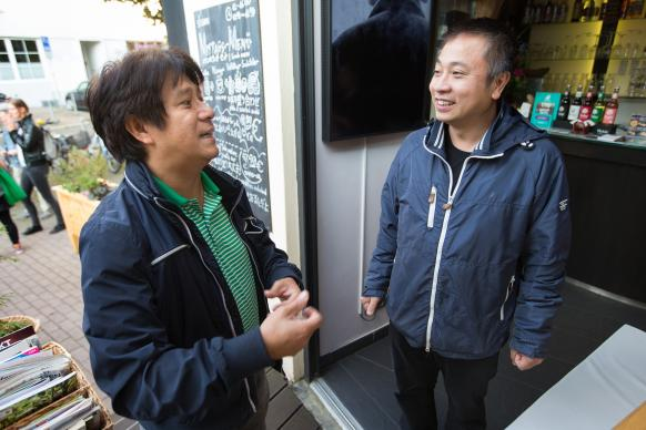 The Rev. Chi My Nguyen (left) visits with parishioner Nguyen Trung Dung at his sushi restaurant in Frankfurt, Germany.  Nguyen is the only Vietnamese United Methodist pastor in Germany, serving a church of about 40 immigrants in Frankfurt. Photo by Mike DuBose, UMNS.