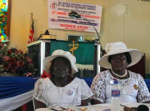 Taryonnoh N. Doe (left), vice president of the Conference of United Methodist Women in Liberia, and Sarah Q. Nah, president, preside over General Resolutions during their 70th Annual Session on Jan. 29. The United Methodist Women in Liberia have launched a campaign to promote the rights of girls, including access to education and freedom from violence. Photo by Julu Swen, UMNS.