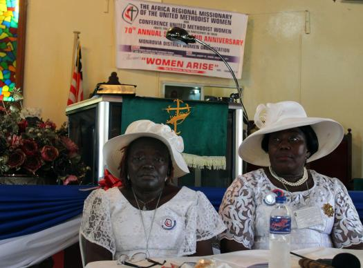 Taryonnoh N. Doe (left), vice president of the Conference of United Methodist Women in Liberia, and Sarah Q. Nah, president, preside over General Resolutions during their 70th Annual Session on Jan. 29. The United Methodist Women in Liberia have launched a campaign to promote the rights of girls, including access to education and freedom from violence.
