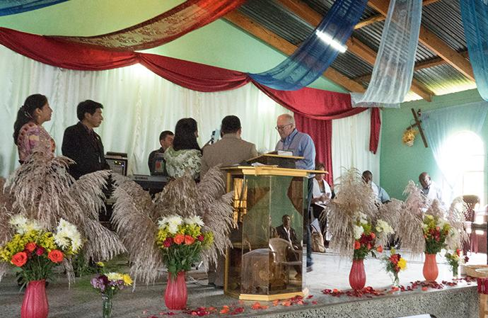 United Methodist Bishop Mike McKee, North Texas conference, accepts gifts from Evangelica Nacional Metodista Primitiva de Guatemala church leaders during a worship service at Iglesia Nacional Methodista Primitiva Fuente De Vida.