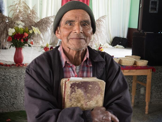 Manuel Ixtan Gerõnimo, a member of the congregation at Iglesia Nacional Methodista Primitiva Fuente De Vida, said he has been planting seeds about Christ's words from the Bible he has had for 40 years.