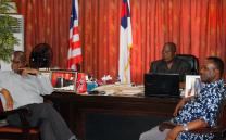 Professor Johnson N. Gwaikolo, center, president of United Methodist University in Monrovia, Liberia, sits in his office with Dr. Mator M. F. Kpangbai, left, and the Rev. George Weagba. Gwaikolo said the university is grateful for a grant from the United Methodist Board of Global Ministries that will allow its College of Health Sciences to be moved from Ganta United Methodist Hospital to a new location with classrooms, laboratories and a generator house. Photo by Julu Swen, UMNS.