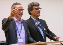 The Rev. Lothar Elsner (left) and Thomas Kemper welcome participants to the International Health Forum of The United Methodist Church in Stuttgart, Germany. Elsner is president of the Bethany Deaconess Foundation in Frankfurt and Kemper is top staff executive of the denomination's Board of Global Ministries. Photo by Mike DuBose, UMNS.