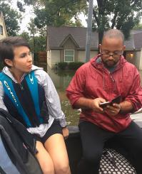 The Rev. R. DeAndre Johnson and his wife, Kelsey, get evacuated by boat on Aug. 27, after their Houston area home took on nearly a foot of water. A team from Christ United Methodist Church in Sugar Land, where Johnson is on staff, got the Johnson family to safety. Photo courtesy the Rev. Chapell Temple.