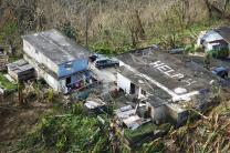 While conducting search and rescue in the mountains of Puerto Rico, a CBP (U.S. Customs Border Patrol) Air and Marine Operations Black Hawk located this home a half mile from the peak of a hill with HELP painted on its roof. Photo by Kris Grogan, U.S. Customs Border Patrol.