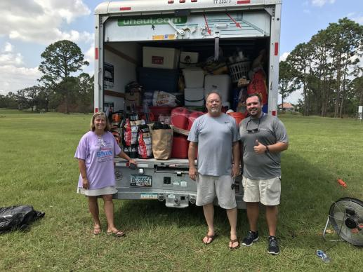 The Rev. John Hill, pastor of Big Pine United Methodist Church, the Rev. Terri Hill, pastor of Key West United Methodist Church, and the Rev. Rob Tucker, associate pastor of Suntree United Methodist Church, stand outside truck filling with donations.