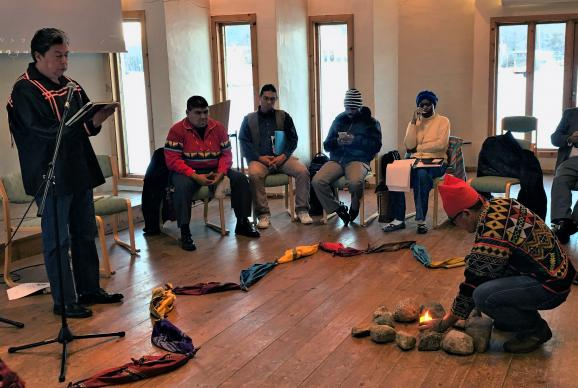 The Rev. David Wilson, left, superintendent of the United Methodist Oklahoma Indian Missionary Conference, leads a morning meditation focused on land during the gathering of indigenous peoples in Soltun, Norway. Photo courtesy of Levi Bautista.