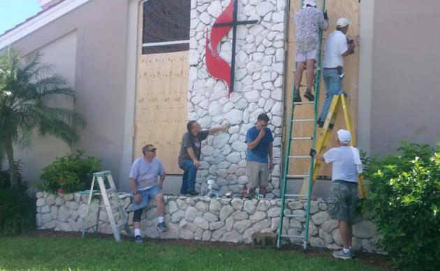 Volunteers board up windows at East Naples United Methodist Church in Naples, Fla., in preparation for Hurricane Irma. Photo courtesy of East Naples United Methodist Church via Facebook.