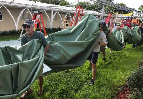 Volunteers secure a canopy at Christ Church, Fort Lauderdale, Fla., in preparation for Hurricane Irma. Photo courtesy of Christ Church, Fort Lauderdale, via Facebook.