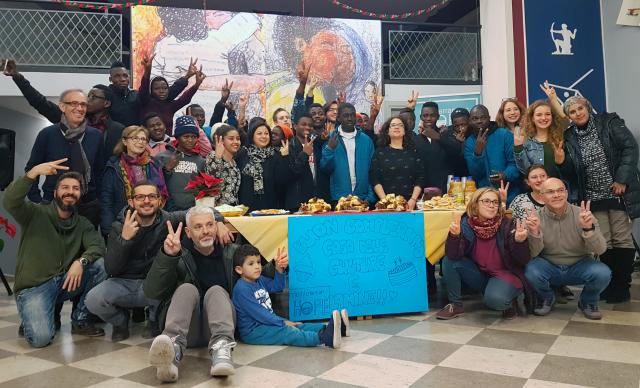 A group of residents, volunteers and staff celebrate the birthday of a boy living in the Casa delle Culture in Scicli, Italy. The facility is a joint program of the local Methodist church and Mediterranean Hope, a project of the Federation of Protestant Churches in Italy. Photo courtesy of MH - Casa delle Culture.