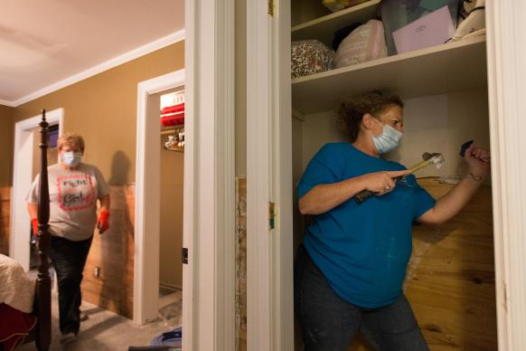 Volunteers Lesa Parmer (right) and Kathleen Stoll of First United Methodist Church in Logansport, La., remove flood-damaged drywall at a home in Crowley, La., in August 2016. The Louisiana Conference's flood recovery ministry is asking for continued volunteer response to continue the work. File photo by Mike DuBose, UMNS.