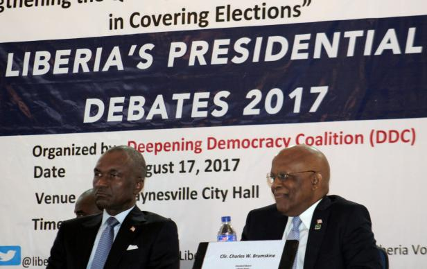 Alexander B. Cummings (left), a 2017 presidential candidate in Liberia, and Charles Brumskine, a Liberian politician and attorney, listen during the presidential debate in Paynesville City, Liberia. The Civil Society and Trade Union Institutions of Liberia, now headed by United Methodist Church leadership, says it will not endorse presidential candidates whose platforms do not consider Liberia's labor force. Photo by Julu Swen, UMNS.