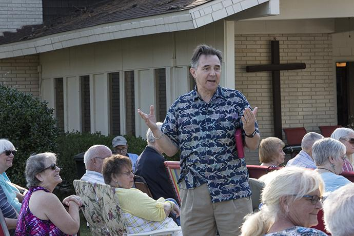 The Rev. Frank Coats, pastor of Lake Houston United Methodist Church in Huffman, Texas, leads the outdoor Sunday service. Photo by Kathleen Barry, UMNS.