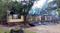The residence where Dr. Shane Sam Mathew lived at Ganta United Methodist Mission in Liberia lies in ruins after a fire that killed the visiting dentist and nursing instructor from India. Photo by Julu Swen, UMNS.