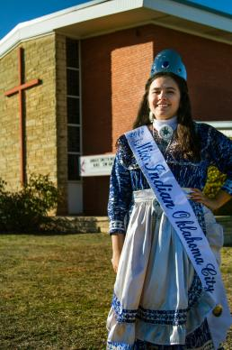2016 Miss Indian Oklahoma City Princess Madeleine Freeman stands in front of her home church, Angie Smith United Methodist Church, a part of the Oklahoma Indian Missionary Conference. Photo by Ginny Underwood, UMNS.