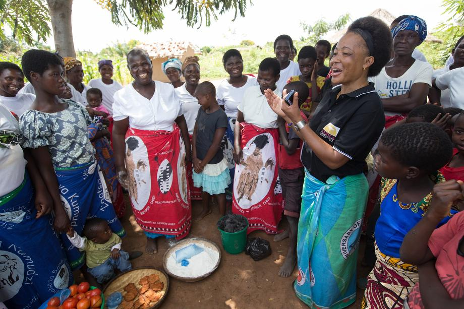 "Mercy Chikhosi (in black shirt) regularly visits with the women of Nkhafi village in Malawi. She has an easy rapport with members of the village. ""I developed a strong bond and a relationship so I continue visiting, influencing and motivating them to identify their needs and find solutions with local resources,"" Chikhosi said. Photo by Mike DuBose, UMNS."