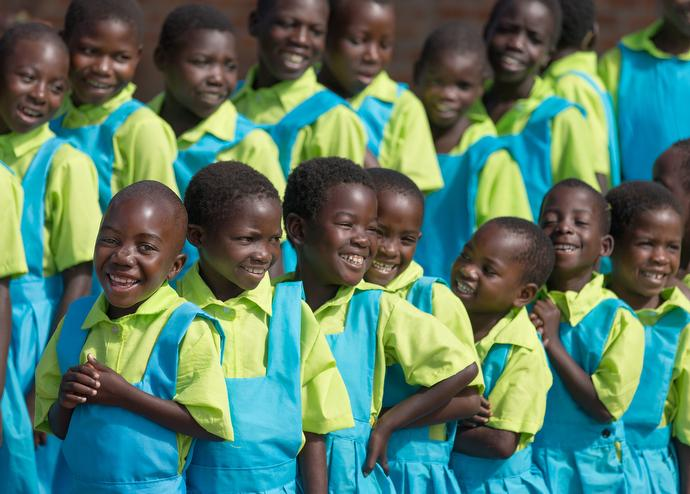 Students celebrate their new uniforms at Liuto Primary School near Madisi, Malawi. The uniforms were bought with donations from several United Methodist churches in Middle Tennessee. Photo by Mike DuBose, UMNS.