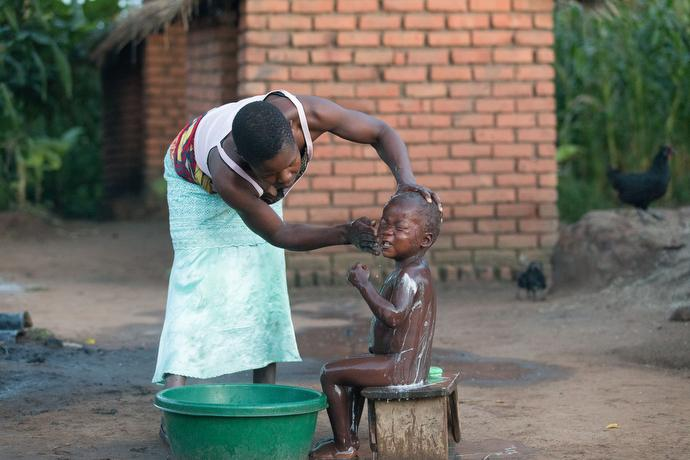 Violet Chandawira bathes her son Demphero Muaza in Mzira, Malawi. Photo by Mike DuBose, UMNS.