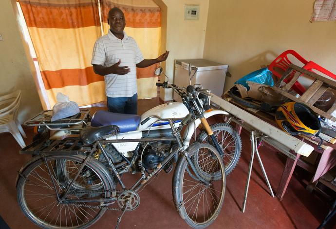 The Rev. Francis Chimseu has five churches in his circuit and the motorcycle that he uses for transportation is broken, forcing him to use a bicycle. Chimseu, pastor of Madisi United Methodist Church in Madisi, Malawi, is a graduate of Africa University. Photo by Mike DuBose, UMNS.