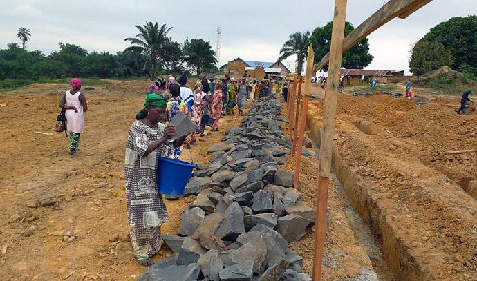 Women leaders and rape survivors join together in laying the foundation of the Mama Lynn Center in Kindu, East Congo. The center will give Congolese rape survivors a chance to heal and overcome the crippling stigma that makes them outcasts. Photo by Judith Osongo Yanga, UMNS.