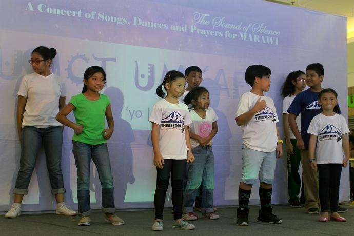 Children of members of the United Methodist Young Adult Fellowship perform a dance during a concert Dec. 7 in Waltermart, Cabanatuan City, in support of Filipinos under siege in Marawi. The Sound of Silence Concert of Dances, Songs and Prayers for Marawi was sponsored by United Methodists in the Middle Philippines Conference to raise awareness about the five-month siege of Marawi City by pro-Islamic State forces. Photo by Gladys Mangiduyos, UMNS.