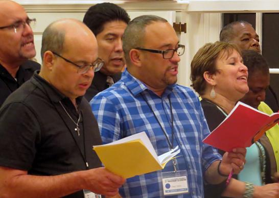 Spirited singing was a part of opening worship during the 46th MARCHA Assembly, held Aug. 10-13, in Dallas. Photo by Sam Hodges, UMNS.