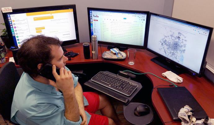 Matthew Marchetti, a member of Chapelwood United Methodist Church in Houston, looks at three computer screens as he works to locate people who need rescuing during Hurricane Harvey. Marchetti, along with fellow Chapelwood member Oliver Carter, came up with a design for a web app, HoustonHarveyRescue.com, to help connect those in need with volunteer rescuers.