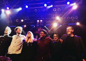 "Mike McHargue, far right, joins members of the Gungor Musical Collective on stage at The House of Blues in San Diego. His ""Ask Science Mike"" podcast receives upward of 6,500 downloads a day, and he is in the iTunes ""Top 20"" podcasters based on measureable internet metrics. Photo courtesy of Mike McHargue."