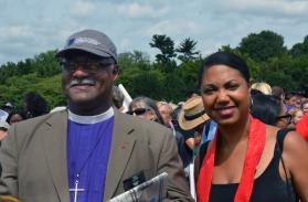 "Indiana Area Bishop Julius Trimble with the Rev. Stacey Cole Wilson, director of Congregational Excellence and Strategic Partnerships for the Baltimore-Washington Conference. Both took part in the ""Ministers March for Justice on Aug. 28 in Washington. Photo by Erik Alsgaard, UMNS."