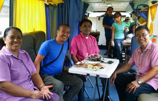 "A new mobile bus clinic was donated to help United Methodists reach ""more patients in far-flung areas,"" said Bishop Rodolfo Juan, pictured third from left. The mobile bus clinic was donated by Riza Angara-Moises of the Genesis Transport Service, Inc., through Homer Garong, a United Methodist lawyer. Photo courtesy of Bishop Rodolfo Juan."