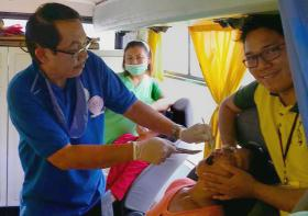 A patient receives medical treatment in the United Methodist mobile clinic. Photo courtesy of Bishop Rodolfo Juan.