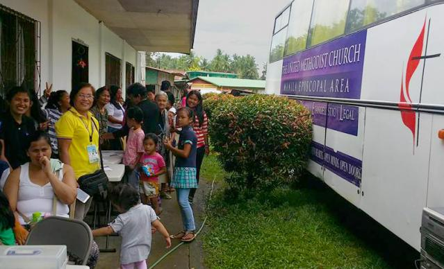 The first United Methodist mobile clinic in the Philippines offered services for the first time on Feb. 20 at Greene Academy, a United Methodist high school in the San Vicinte barangay in the town of Makilala. More than 100 people received medical and dental care from two doctors and four dentists at the clinic. Photo courtesy of Bishop Rodolfo Juan.