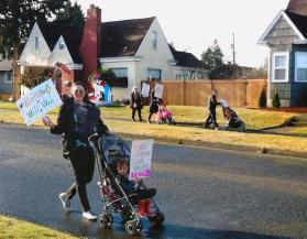 Women from ConnexíonTacoma, a new faith community in Tacoma, Washington, led by the Rev. Abigail Vizcarra Perez, decided to have a mini-march in their neighborhood for International Women's Day on March 8. Photo courtesy of ConnexíonTacoma.