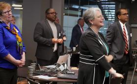 The Rev. Sandra Olewine, Reggie Clemons, Kathryn Croskery Jones and Vasanth Victor (from left) join in worship at the General Council on Finance and Administration board meeting in November in Nashville, Tenn. Photo by Heather Hahn, UMNS