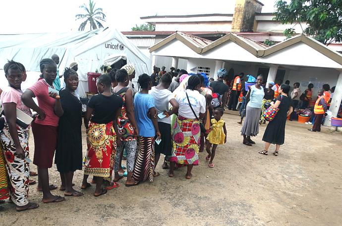 In a photo from September, 2017, survivors of a deadly mudslide on Aug. 14 near Freetown, Sierra Leone, line up at Old School Camp to receive relief items from the Sierra Leone Annual Conference disaster response team. The team distributed good including items specifically for women and children, along with 200 bags of rice — Sierra Leone's staple food. Photo by Phileas Jusu, UMNS.