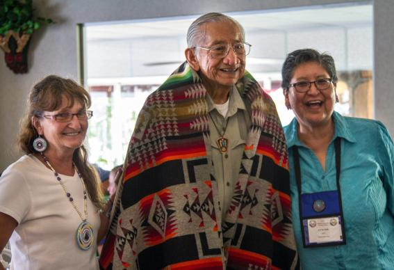 A highlight of the Native American International Caucus' Family Camp held July 24-27, 2017, in Gore, Okla., was a luncheon honoring the life work of the Rev. Homer Noley (center), a member of the Choctaw Nation. He's pictured with Ragghi Rain, Family Camp co-coordinator (left) and Cynthia Kent, chair of the Native American International Caucus. Photo by Ginny Underwood, UMNS.