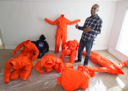 Ndume Olatushani, a death row exonoree, is one of the artists whose work is included in Stations of the Cross opening in Washington during Lent. Using chicken wire, Olatushani molds the jumpsuits into prisoners bowed and writhing in agony from being confined. Photo by Mike DuBose, UMNS.