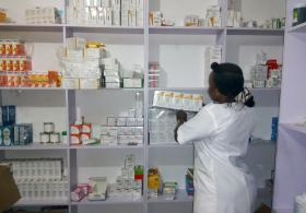 Pharmacist Dickens Ayuba picks up a carton of medicines at United Methodist Church of Nigeria General Hospital in Jalingo, Nigeria. Photo by the Rev. Ande I. Emmanuel, UMNS.