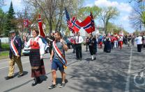 The Rev. Kristin Sundt, front, in traditional Norweigan clothing, leads members of the congregation from Norwegian Lutheran Memorial Church in Minneapolis, Minnesota, known as Mindekirken, in a parade celebrating Norwegian Constitution Day. The church marks the day each year on the weekend closest to May 17. Photo courtesy of Kristin Sundt.