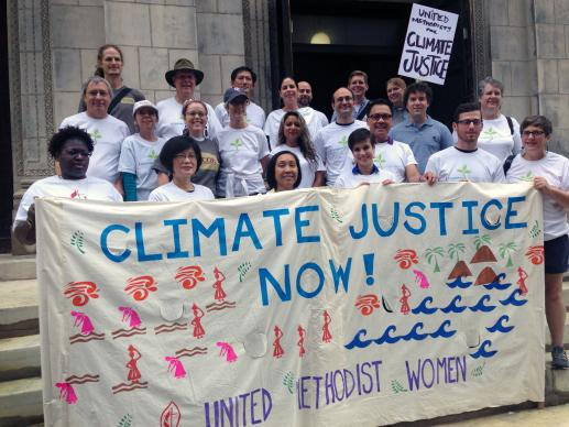 One group of United Methodists participating in the People's Climate March in 2014 gather on the steps of the United Methodist Church of Saint Paul and Saint Andrew in Manhattan before heading south to join the interfaith gathering on 58th Street. Estimates of the number of participants ranged between 300,000 to 400,000. File photo by Linda Bloom, UMNS