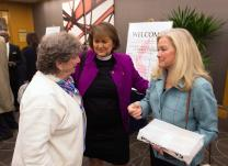 Bishop Karen Oliveto (center) visits with her mother, Nelle Oliveto (left) and her wife, Robin Ridenour outside the April 25 meeting of the United Methodist Judicial Council meeting in Newark, N.J. Photo by Mike DuBose, UMNS.
