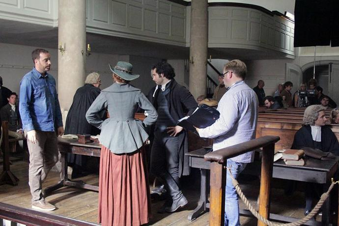 "The New Room, an 18th century chapel built by John Wesley in 1739 in Bristol, England, was featured in Season 2 of the PBS period drama, ""Poldark."" Pictured are actors Aidan Turner (center, in black) and Eleanor Tomlinson (to his left), who play Ross and Demelza Poldark. Photo courtesy of Mammoth Screen."
