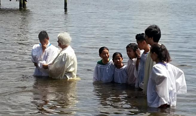 The Rev. Connie Stutts baptizes new Christians in the Neuse River in New Bern, N.C. Rhems' membership is now about 60 percent Karen and other refugees from Burma. Photo courtesy of Rhems United Methodist Church.